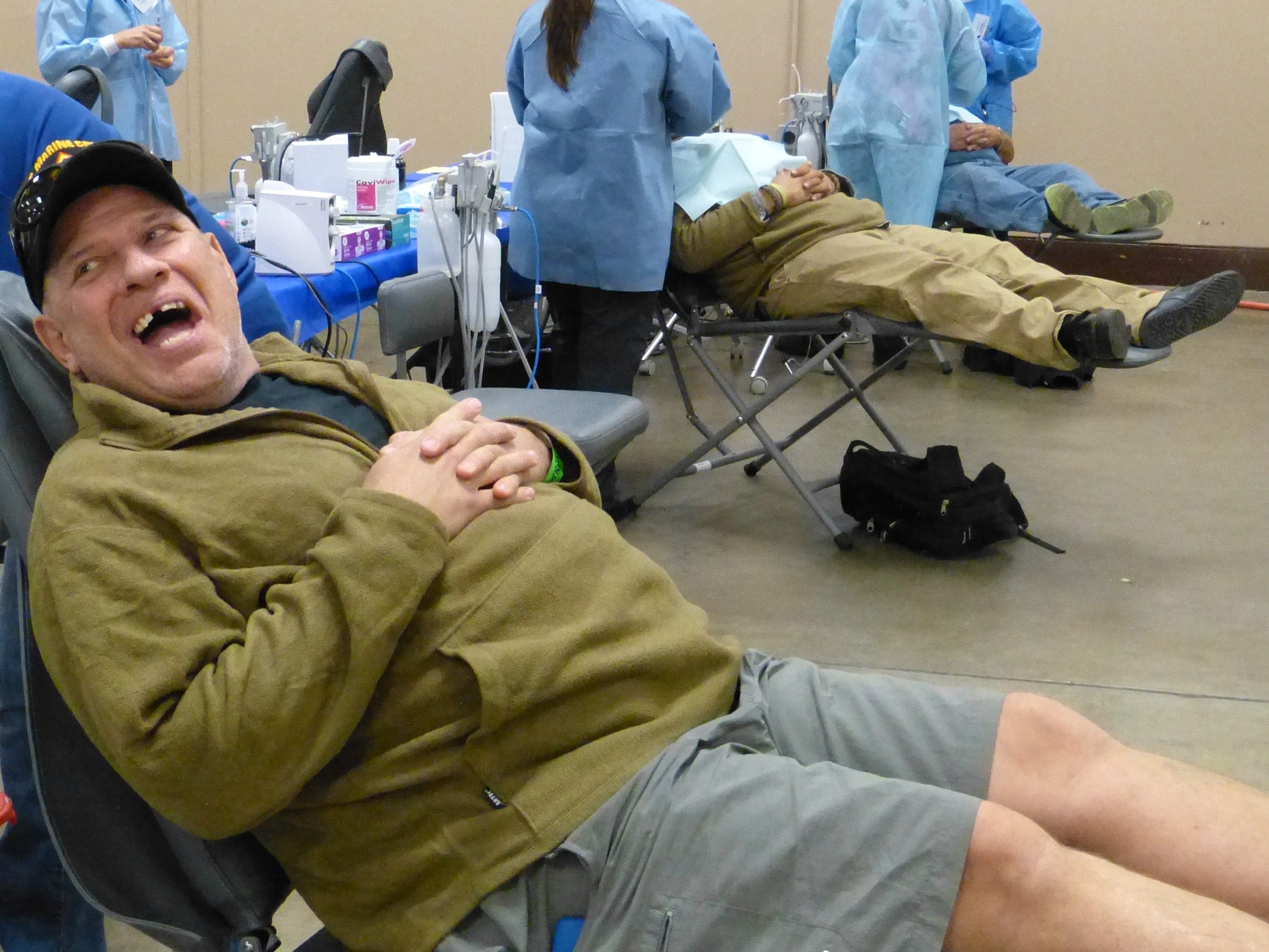 Fifty-six-year-old Steve Bidwell, a U.S. Marine Corps veteran, was in good spirits Friday before having dental work at the North Valley Stand Down.
