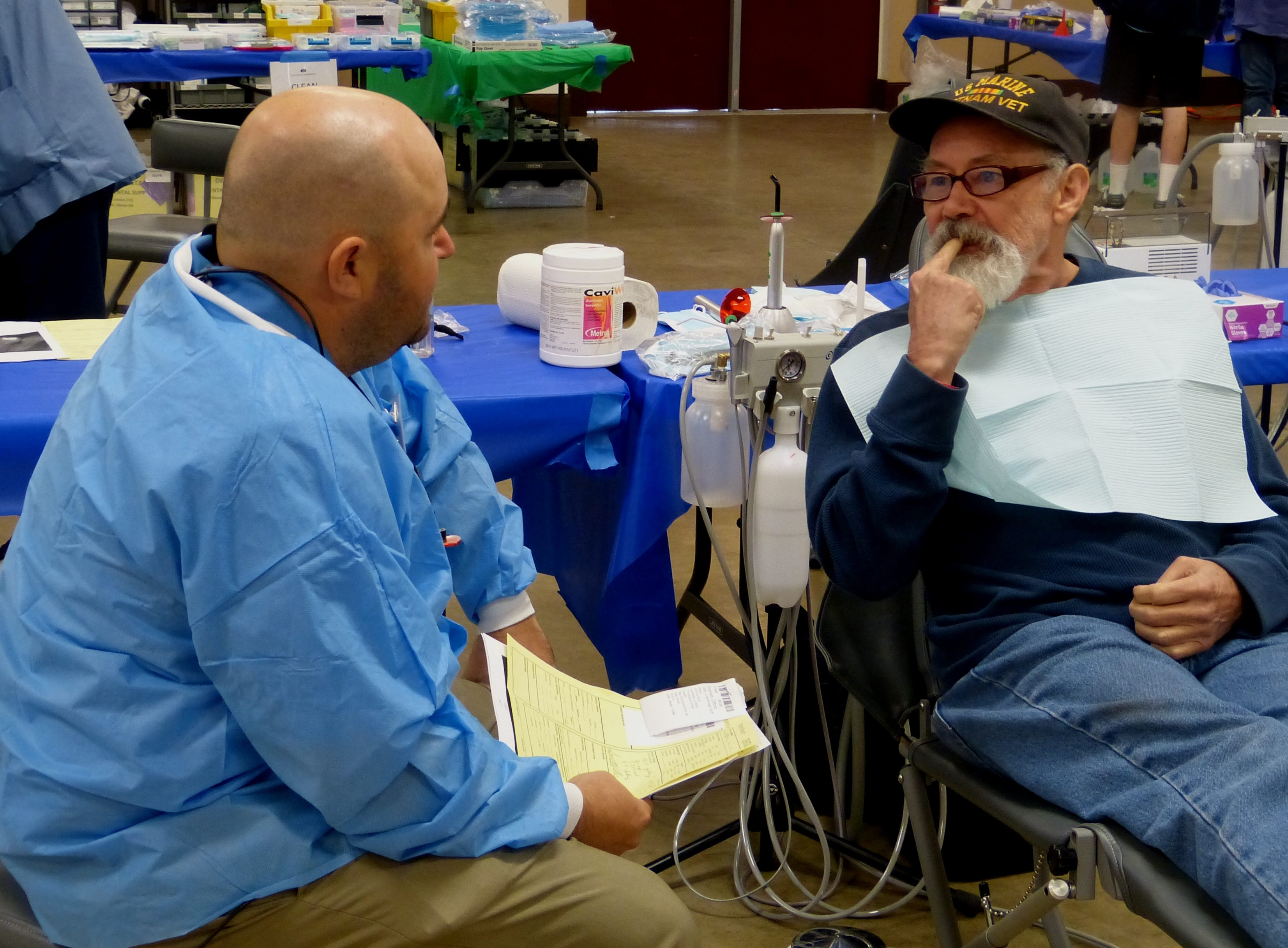 Veteran Cliff Emerson confers with dentist Maurice Trusas at the North Valley Stand Down.