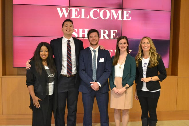 The winners of the Ratcliffe Shore Hatchery at Salisbury University pose following a Shark Tank type competition on Friday, Oct. 26. From left, are second-place winner Arion Long of Femly, first- place winner Aaron Hsu of ClearMask, fourth-place winners Dan Fucich and Kelsey Abernathy of Algen Air and third-place winner Lisa Ball of Plum Dragon Herbs. Hsu, the first-place winner, received $30,000 to develop a full-face transparent surgical mask.