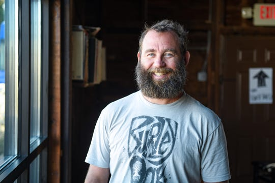 Bryan Brushmiller, owner of the Burley Oak Brewery, poses at his business in Berlin on Wednesday, Oct 24, 2018.