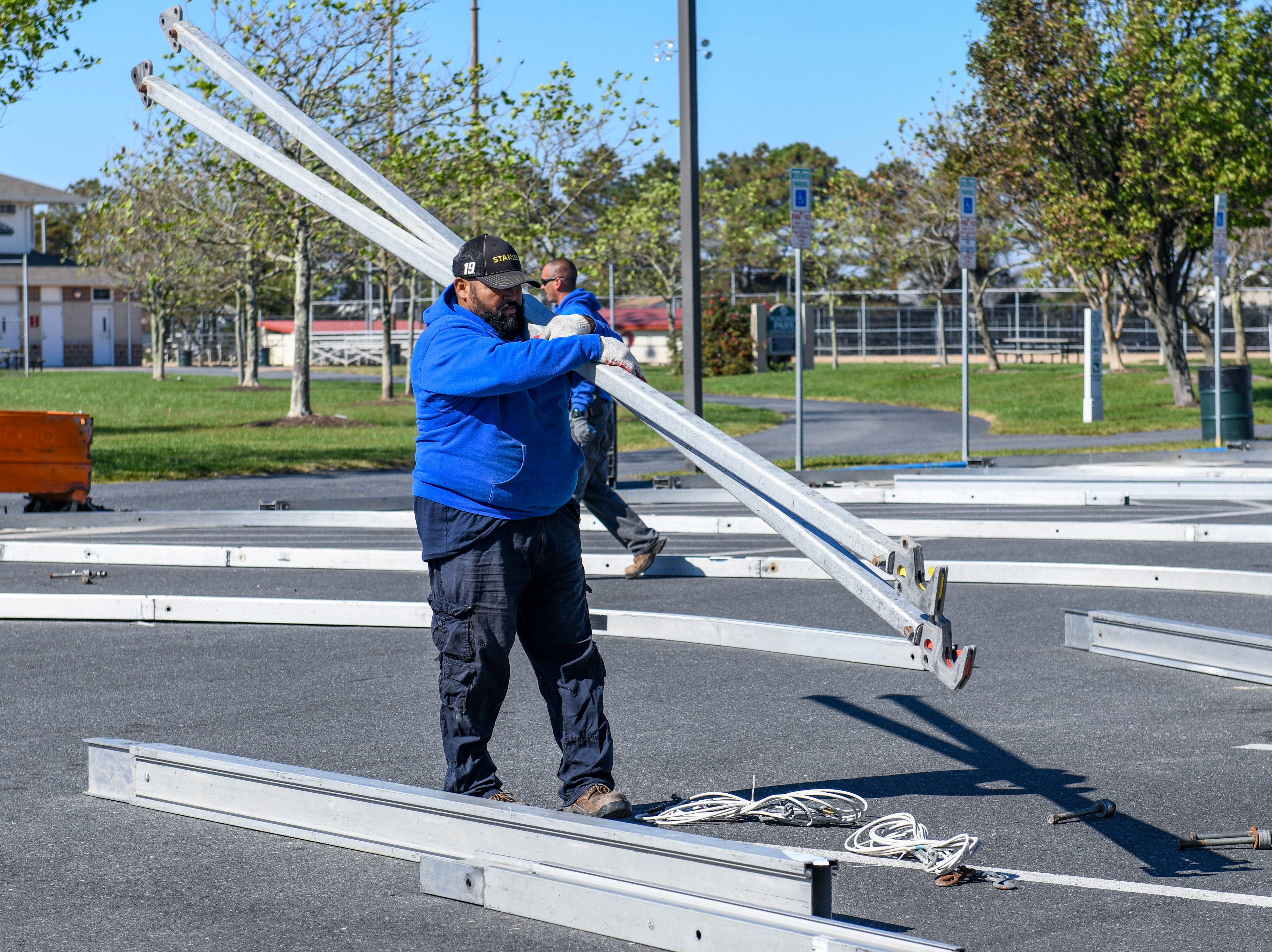 Workers set up preparations for Winterfest, which are well underway weeks before the event in Ocean City's Northside Park on Monday, Oct 22, 2018.