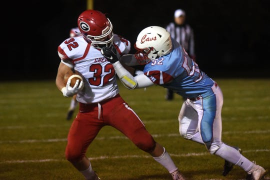 Bon Homme's Riley Hellmann (52) grabs Gregory's JJ Beck's (32) face mask during a game in Tyndall, S.D., Thursday, Oct. 25, 2018.