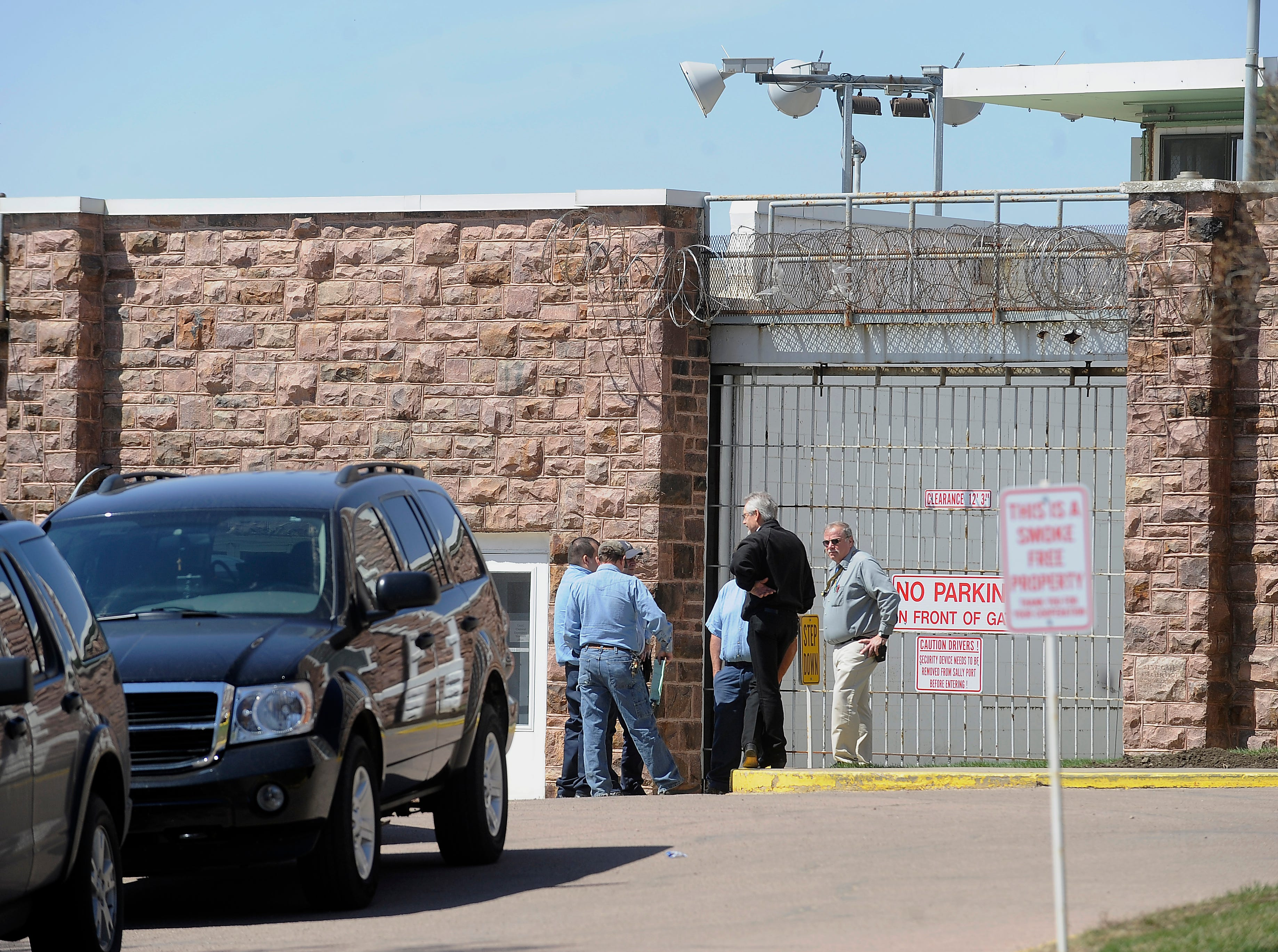Entrance to the South Dakota State Penitentiary in Sioux Falls, S.D. Tuesday where a correctional officer was killed during an escape attempt, April 12, 2011. The officer was transported by ambulance to a Sioux Falls hospital and was pronounced dead at 11:50 a.m. Two inmates, Rodney Berget and Eric Robert, were apprehended within the confines of the prison grounds during the escape attempt just before 11 a.m. (Elisha Page/Argus Leader)