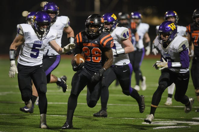 Washington's Tupak Kpeayeh breaks free for a 52-yard run, that breaks the state's all time career 11-man rushing record during the first quarter against Watertown Thursday, Oct. 25, at Howard Wood Field in Sioux Falls.