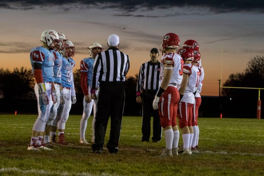 Bon Homme and Gregory players line up for the coin toss in Tyndall, S.D., Thursday, Oct. 25, 2018.