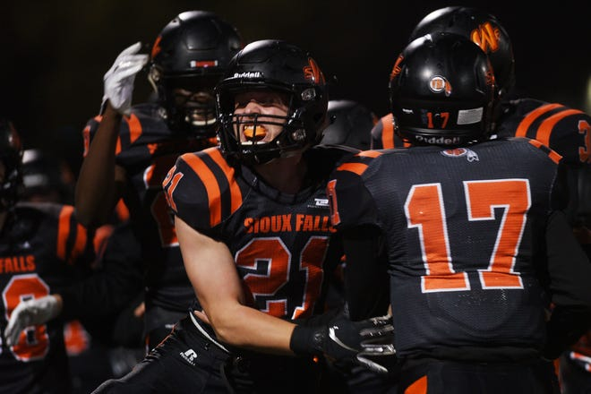 Washington's Robert Dougherty celebrates with his team on the sidelines during the game against Watertown Thursday, Oct. 25, at Howard Wood Field in Sioux Falls.