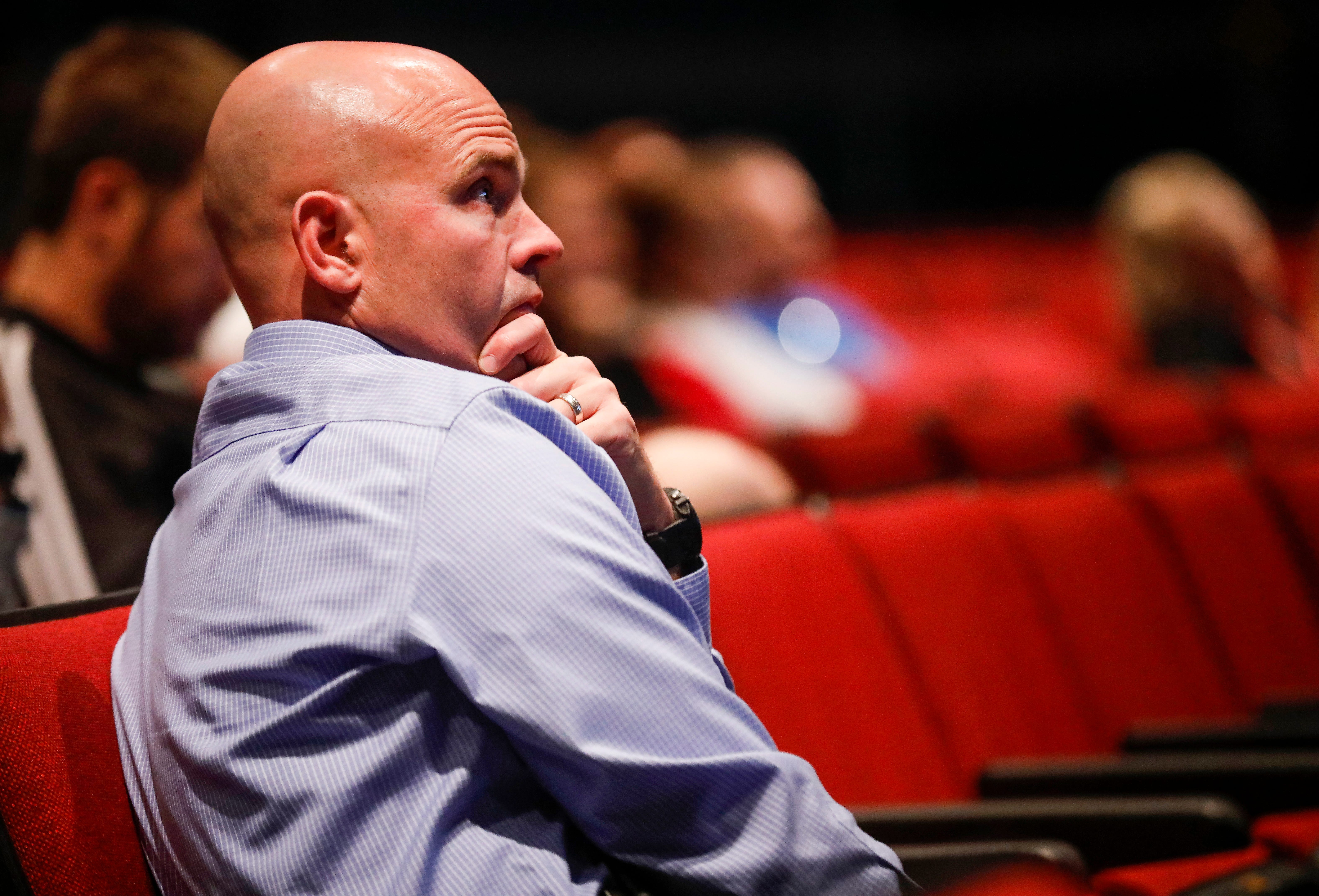 Ozark High School Principal Jeremy Brownfield listens as Jim Brawner, a smoking cessation expert with CoxHealth, gives a presentation on Juul e-cigarettes on Friday, Oct. 26, 2018.