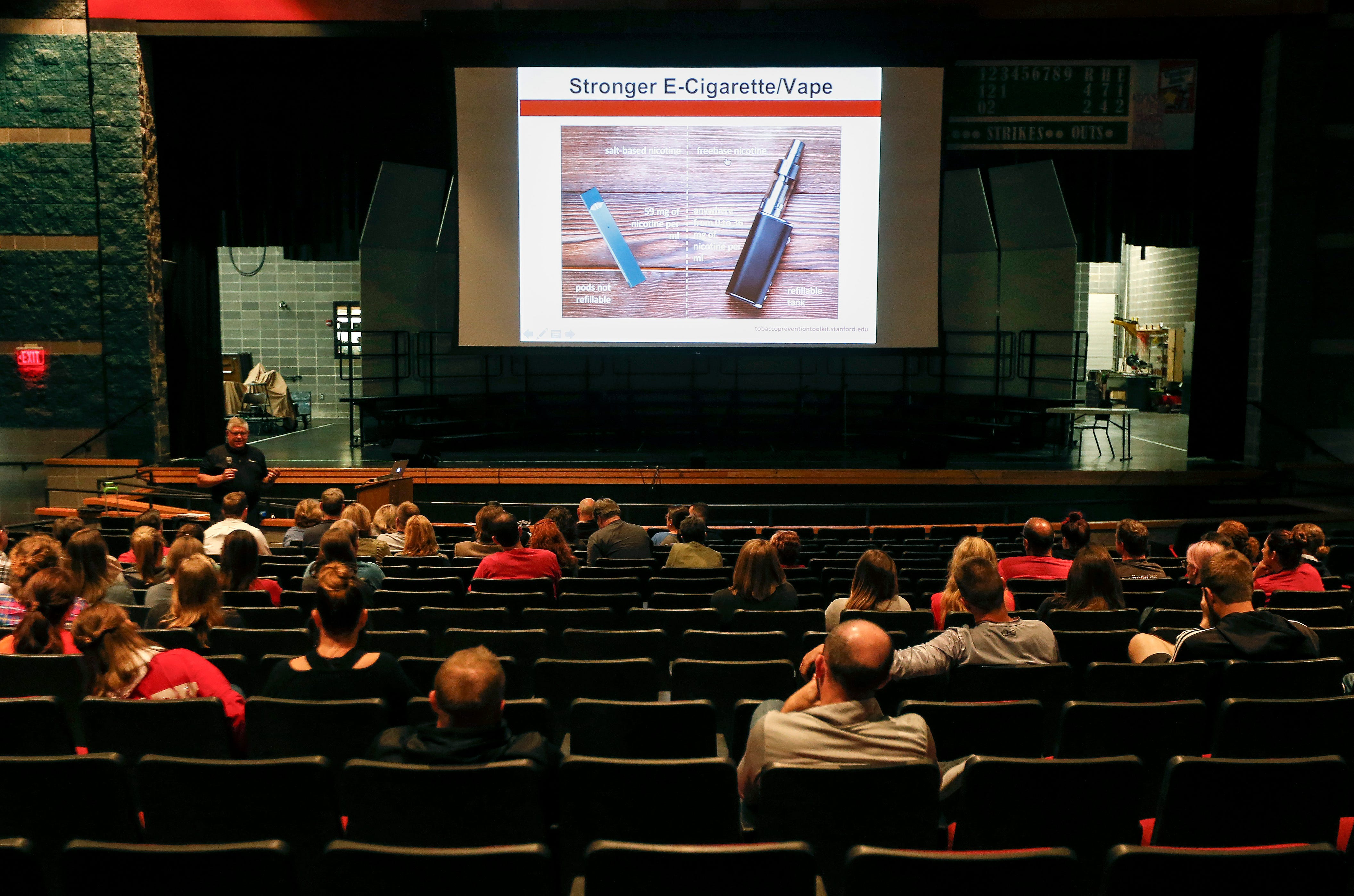 Teachers and staff at Ozark high school listen as Jim Brawner, a smoking cessation expert with CoxHealth, gives a presentation on Juul e-cigarettes on Friday, Oct. 26, 2018.