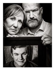 """Mary Jane and Tim hold a photo of their son, Sam, who committed suicide in 2017. They shared their story with Springfield photographer Randy Bacon for the """"It Knows No Face"""" project."""