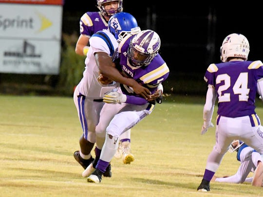 Waynesboro's Kazmaun Johnson is wrapped up from behind and tackled during a game played in Waynesboro on Thursday, Oct. 25. 2018.