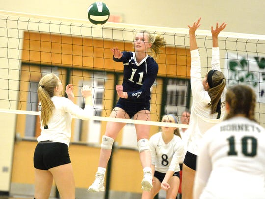 Lee High's Lily Kopia (11) finished the night with 5 kills Thursday in the Shenandoah District volleyball tournament semifinals.