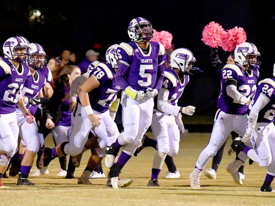 Waynesboro's Kazmaun Johnson (#5) goes high with excitement as their team takes the field for a game played in Waynesboro on Thursday, Oct. 25. 2018.