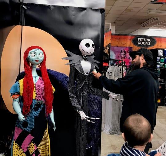 Matt Hewitt, of Waynesboro, checks out Jack Skellington on Friday at the Spirit Halloween.