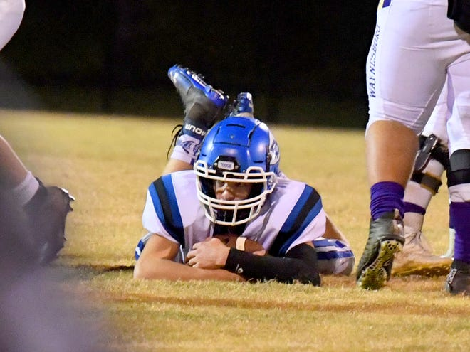 Fort Defiance's Addison Knicely jumps onto a loose ball for a fumble recovery during a game played in Waynesboro on Thursday, Oct. 25. 2018.