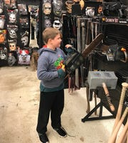 Wyatt Shaffner, 8, of Bridgewater, eyes a chainsaw prop at Spirit Halloween in Waynesboro on Friday.