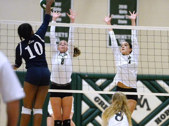Wilson Memorial's Eliza Dana (8) and Olivia Bower (7) go up for the block of Lee High's Rachel Christian Thursday in the Shenandoah District volleyball tournament semifinals.
