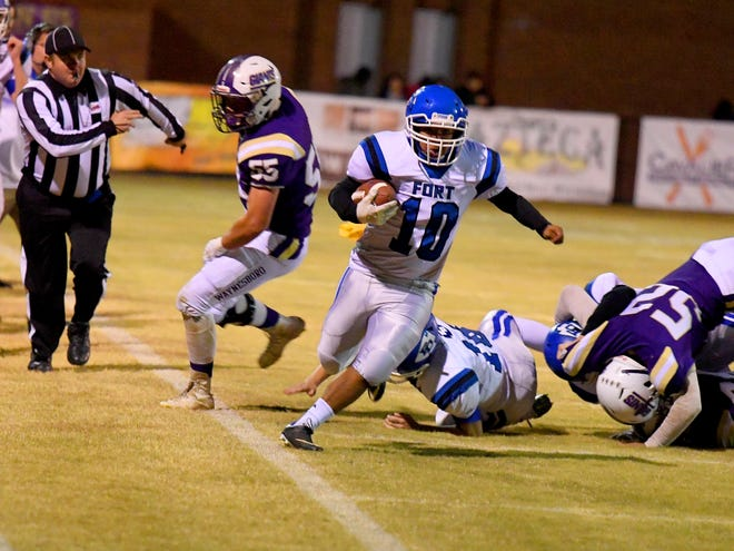 Fort Defiance kicker Jose Ortega-Martinez keeps the ball and runs it on a fake punt during a game played in Waynesboro on Thursday, Oct. 25. 2018. Although he gained the yards for a first down, a holding call against Fort called the ball back with a repeat fourth down.