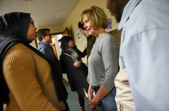 U.S. Senator Tina Smith talks with people during a campaign stop Friday, Oct. 26, at DFL headquarters in St. Cloud.