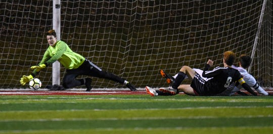 Tech goaltender Christian Engel dives to try to make a save during the Thursday, Oct. 25, Class 2A state quarterfinal game against St. Paul Central at Husky Stadium in St. Cloud.