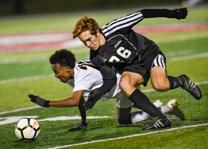 Tech's Aydurus Hassan and Riaz Kelly of St. Paul Central battle for control of the ball during the Thursday, Oct. 25, Class 2A state quarterfinal game at Husky Stadium in St. Cloud. St. Paul Central beat St. Cloud Tech, 6-1.