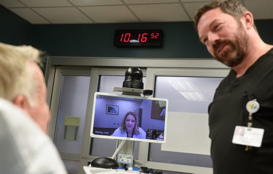 Nurse practitioner Leah Roering observes patient interactions during a demonstration of the TeleStroke system Friday, Oct. 26, at the St. Cloud Hospital