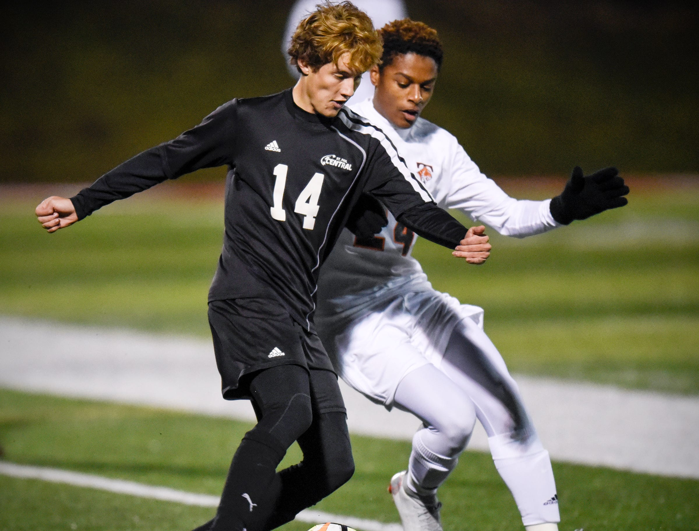 Ronald Hall Jr. of St. Paul Central and Drake Jett of Tech struggle for control of the ball during the Thursday, Oct. 25, Class 2A state quarterfinal game at Husky Stadium in St. Cloud.