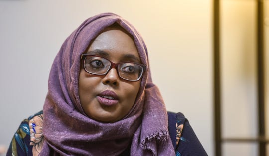 Amal Hassan is a community educator with The Center  for Victims of Torture. She is pictured speaking during an interview Friday, Oct. 26, in St. Cloud.