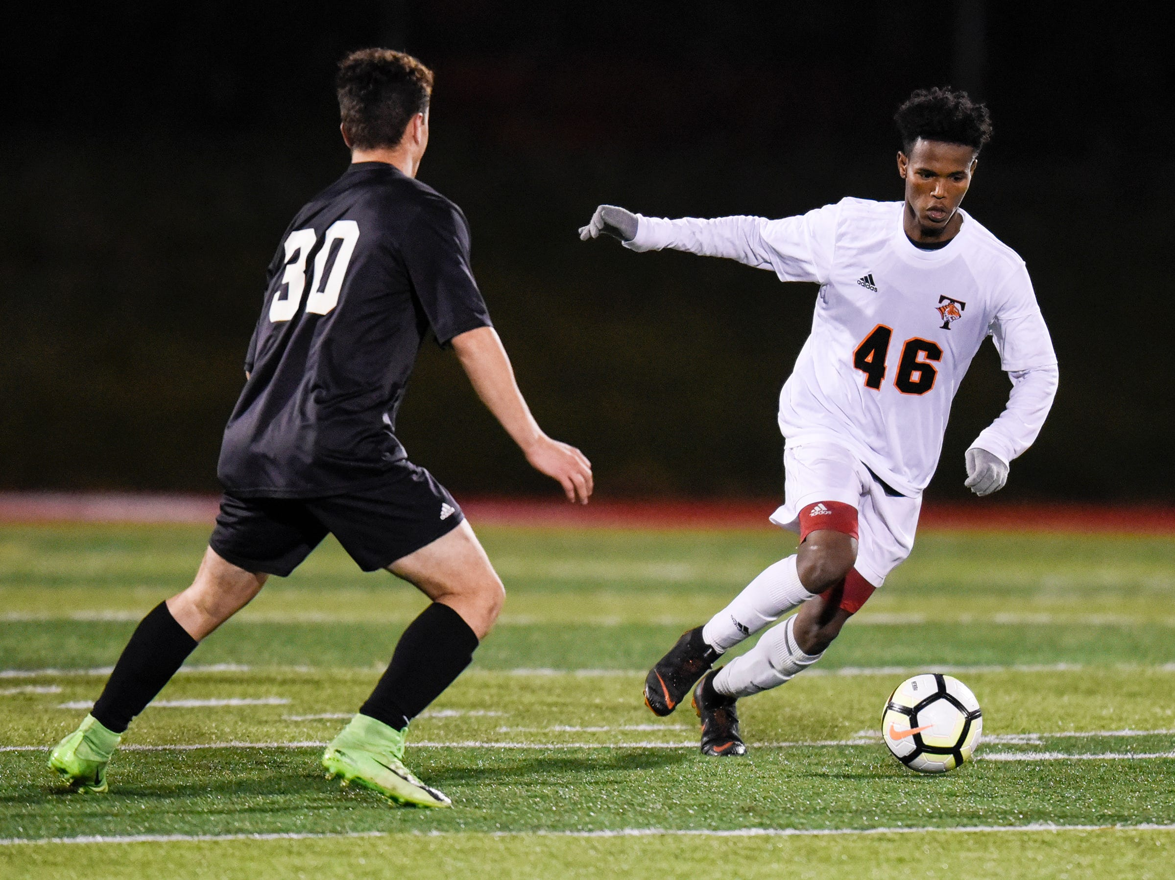 Tech's Keyse Elmi controls the ball during the Thursday, Oct. 25, Class 2A state quarterfinal game against St. Paul Central at Husky Stadium in St. Cloud.