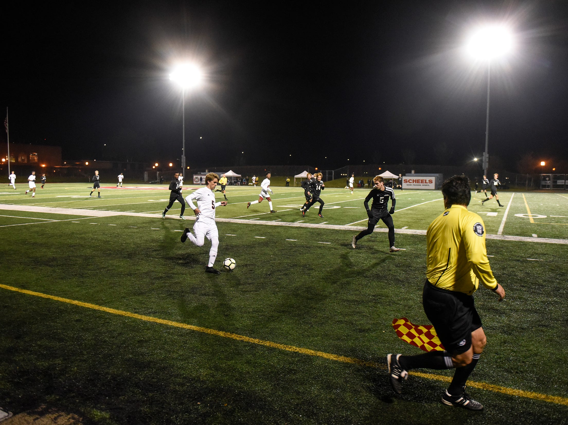 Players compete under the lights during the Thursday, Oct. 25, Class 2A state quarterfinal game at Husky Stadium in St. Cloud.