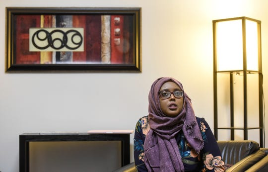 Community educator Amal Hassan explains programs she works with in her role with The Center  for Victims of Torture during an interview Friday, Oct. 26, in St. Cloud.