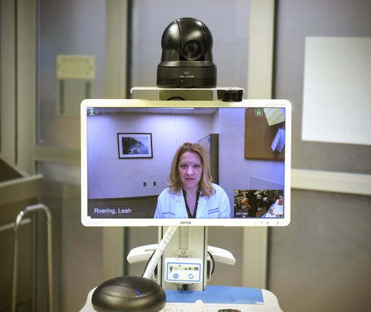 Nurse practitioner  Leah Roering uses the TeleStroke system Friday, Oct. 26, during a demonstration at the St. Cloud Hospital
