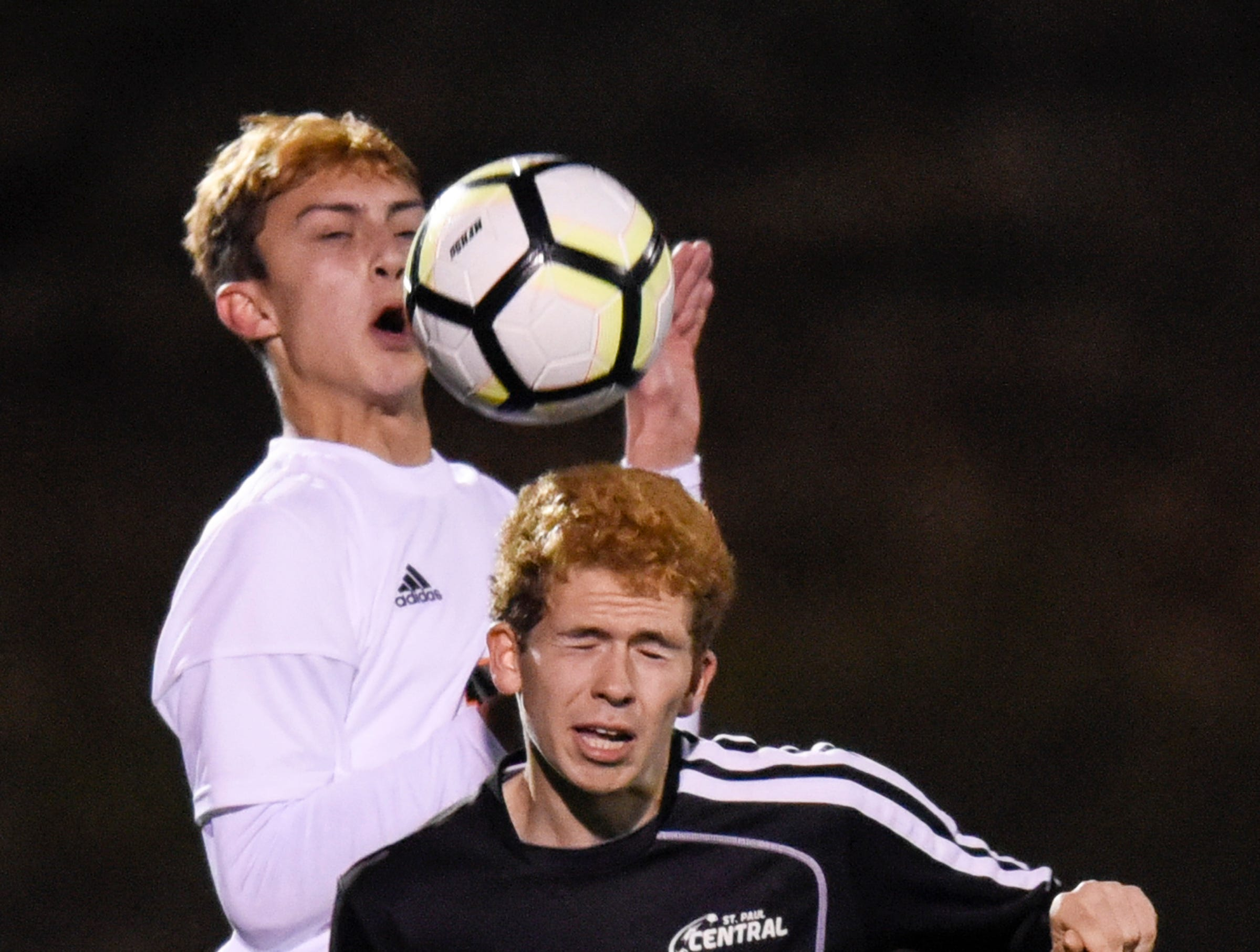 Joseph Pearson of Tech and Daniel Barrett of St. Paul Central during the Thursday, Oct. 25, Class 2A state quarterfinal game at Husky Stadium in St. Cloud.