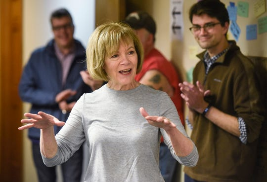 U.S. Senator Tina Smith talks with supporters during a campaign stop Friday, Oct. 26, at DFL headquarters in St. Cloud.