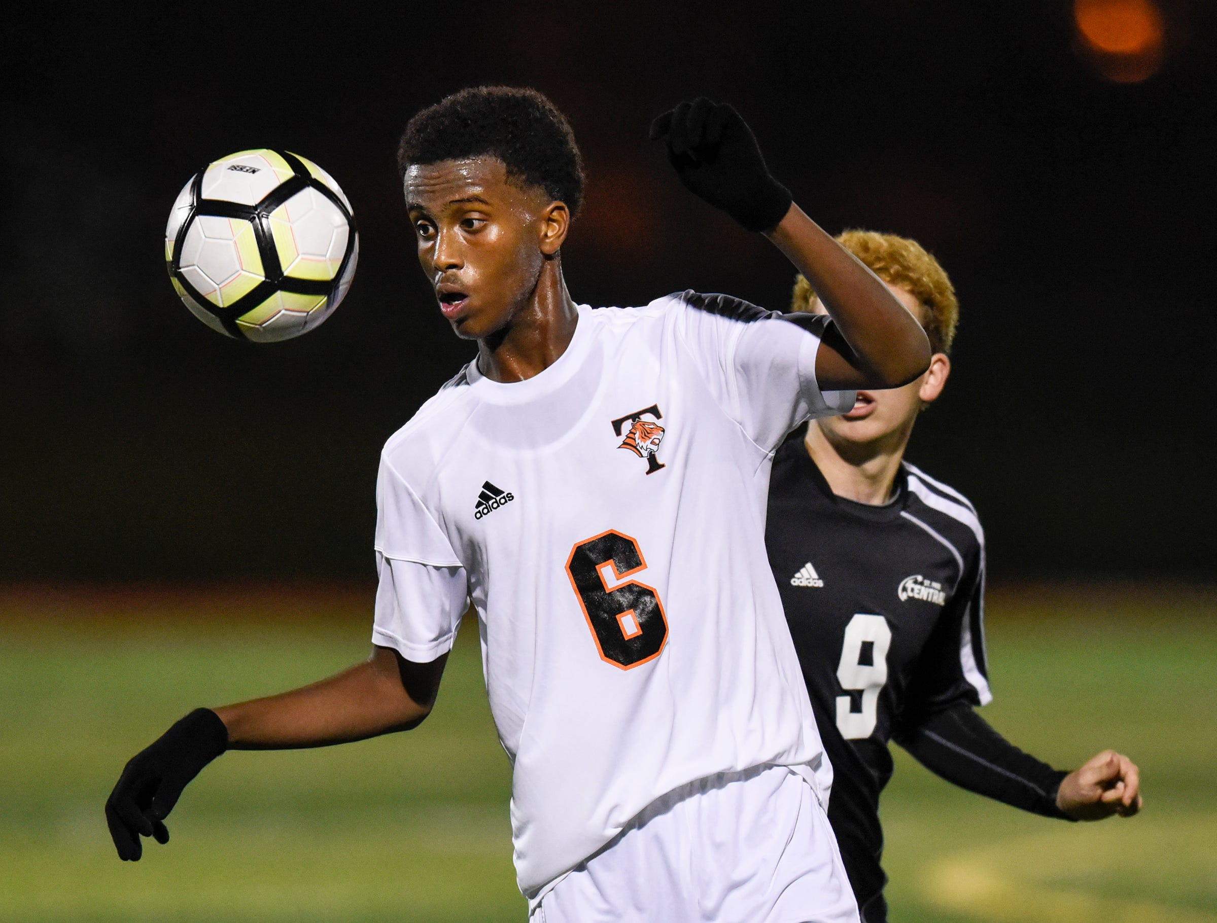 Tech's Zak Mohamud concentrates on the ball during the Thursday, Oct. 25, Class 2A state quarterfinal game at Husky Stadium in St. Cloud.