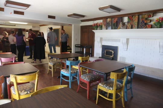 Community members tour the kitchen and common area of Youth Futures on Oct. 26, 2018.