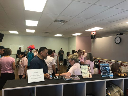 Residents socialize during the grand opening ceremony for the Mesquite-Toes Tap Team's new location at 190 E. Mesquite Blvd.