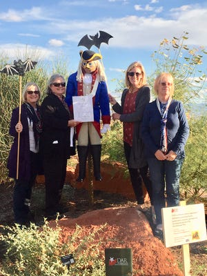 "Members of the Color Country chapter of the Daughters of the American Revolution, from left, Valerie King, Sue McElhaney, Janet Call and Mazelle Nohr, stand alongside ""Colonial George,"" a scarecrow on display at the Red Hills Desert Garden in St. George. The group sponsored a pollinator garden at the garden in recognition of birds, bees, butterflies, bats and other creatures that help plants reproduce and maintain ecosystems."
