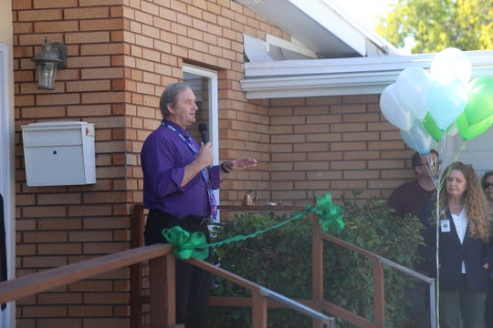 Mike Carr, Washington County School District's homeless student liaison, speaks at the grand opening and ribbon cutting ceremony of Youth Futures, Washington County's first ever youth homeless shelter, Oct. 26, 2018.