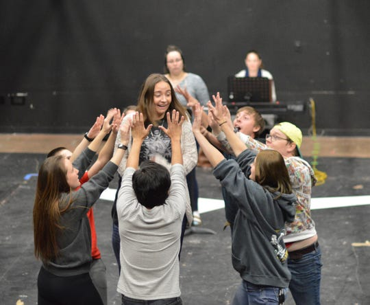 """Adriana Villalobos, center, plays Small Allison during a rehearsal at Southern Utah University with the cast of """"Fun Home."""""""