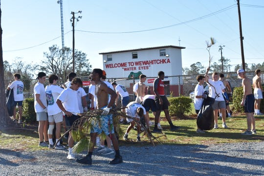 The Maclay football team helps Wewahitchka with clean-up after the school was damaged by Hurricane Michael.
