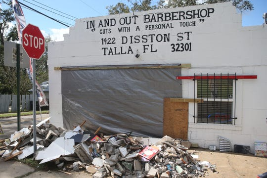 At In and Out Barbershop on Friday, Oct. 26, 2018, located off of Gamble Street in Tallahassee, Fla., the barbershop is left without a storefront wall after, a car crashed into the building overnight.