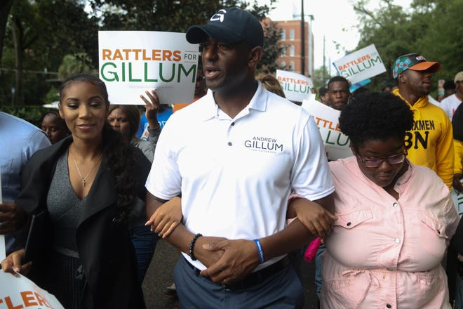 Tallahassee Mayor and candidate for Florida governor Andrew Gillum marches with supporters from the eternal flame on the Florida A&M campus to Florida State University's College of Law to encourage early voting Friday, Oct. 26, 2018.