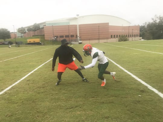 FAMU wide receiver Xavier Smith works on his routes with position coach Jelani Berassa.