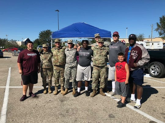 Members of Madison County's football team went to Marianna to cook a hot meal for Armed Forces members helping an area ravaged by Hurricane Michael.