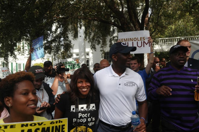 Tallahassee Mayor and candidate for Florida governor Andrew Gillum greets supporters as he arrives at Florida State University's College of Law after marching from the eternal flame on the Florida A&M campus to encourage early voting Friday, Oct. 26, 2018.