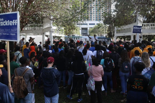 Tallahassee Mayor and candidate for Florida governor Andrew Gillum speaks to supporters on the lawn of Florida State University's College of Law after a march from FSU and the eternal flame on the Florida A&M University campus to encourage early voting Friday, Oct. 26, 2018.