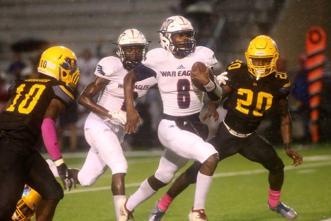 Wakulla quarterback Jaylon Worsham runs for yardage during a 34-0 win over Rickards on Thursday night.