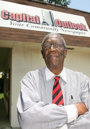 Roosevelt Wilson, publisher of Capital Outlook, stands outside his office on Jennings Street in  June 2008.