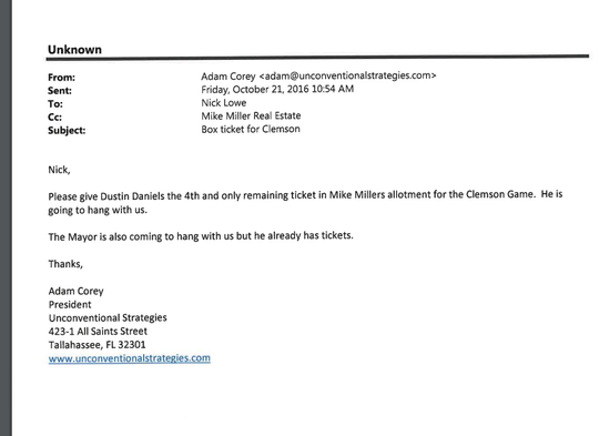 This email from Adam Corey to Nick Lowe directs Lowe to give a Clemson skybox ticket to Dustin Daniels.