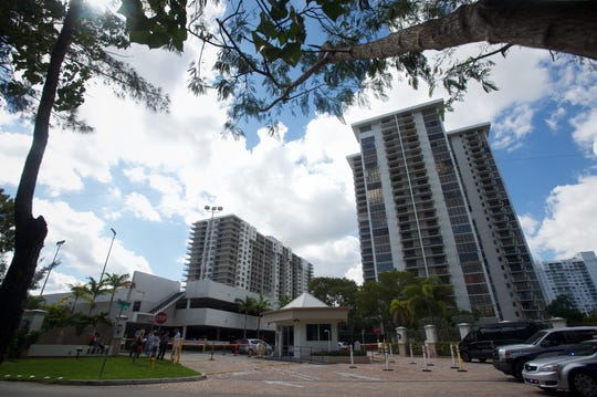 The Clipper at Biscayne Cove Condominium (left) where the Mother of suspect Cesar Sayoc Jr., 56, resides, seen in Aventura, Florida.